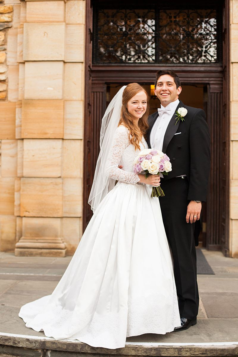 Real Bride Janet in her long-sleeve wedding dress with her groom on their wedding day