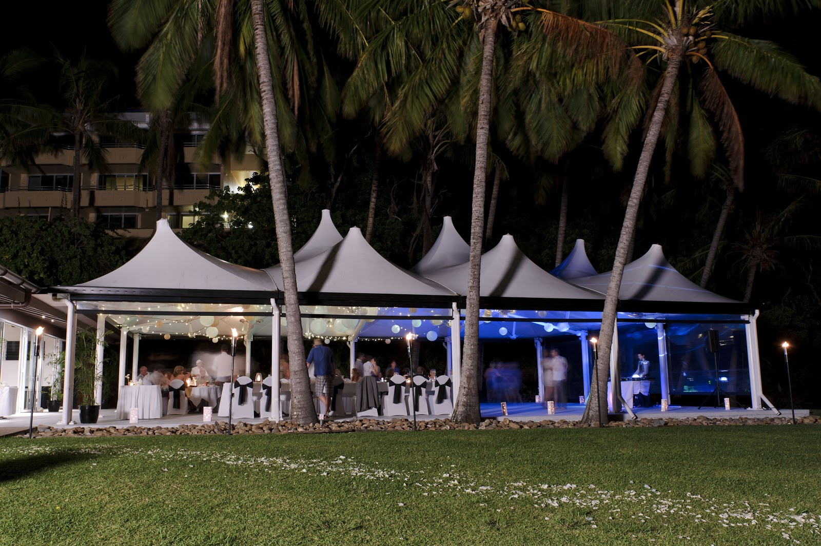 A destination wedding party in a tent.