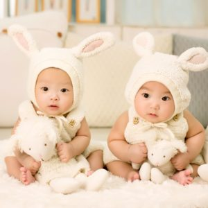 twins in bunny hats.