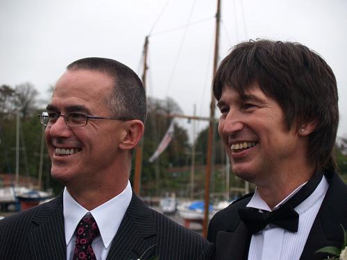 Two smiling men in uniforms.