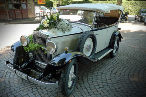 Classic vintage vehicle car with wedding embellishments and decorations.